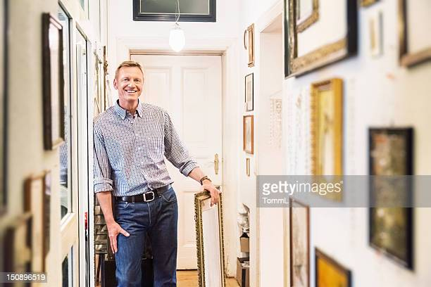 art collector in old apartment corridor - art dealer stock pictures, royalty-free photos & images