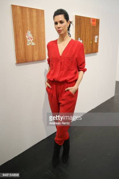 Art collector Julia Stoschek stands next to an artwork of Sazre Gomeyat Nagel and Draxler Gallery booth during the Art Cologne exhibition preview at...