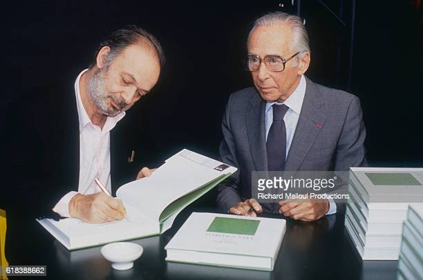 Art collector Leo Castelli and French film director Claude Berri sign copies of the art book that they wrote together entitled Claude Berri Meets Leo...
