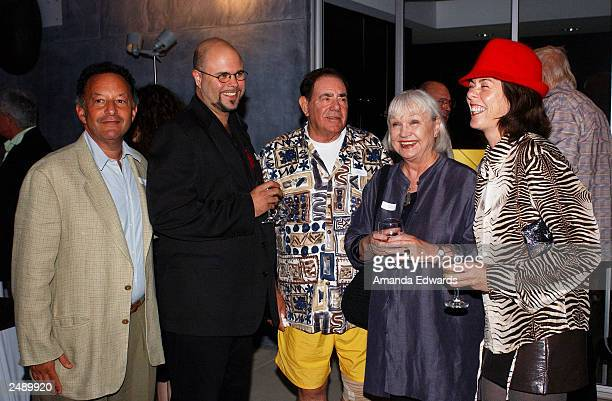 Art collector Robert Gore Rifkind poses with Reverend Ethan Acres Patty Faure and guests at the Santa Monica Museum of Art's Party with Frank Gehry...