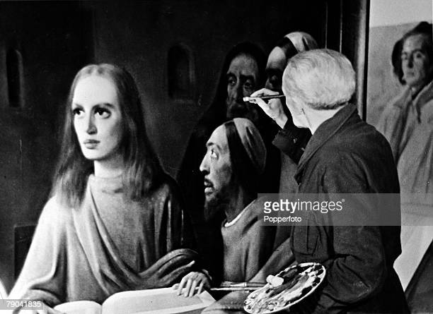 1940's Dutch painter Hans Van Meegeren painter and art dealer pictured applying the finishing touches on his last work 'Jesus Preaching in the...