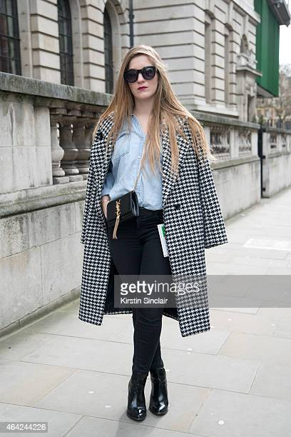 Art Critic Geraldine Pigault wears YSL bag Forever 21 jeans Primark jacket Mahe boots with a vintage shirt on day 3 of London Collections Women on...