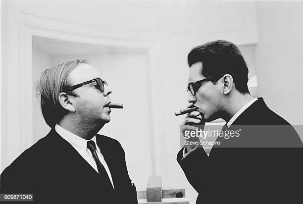 Art curator and historian Henry Geldzahler smokes cigars with American artist Frank Stella New York New York 1965