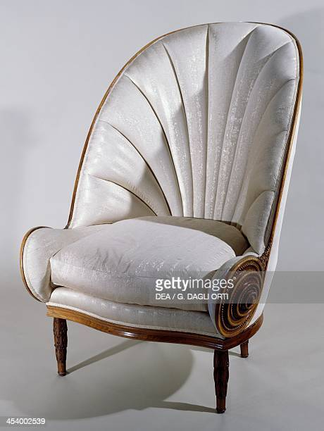 Art Deco armchair, ca 1913, by Paul Iribe , carved rosewood and silk. France, 20th century.