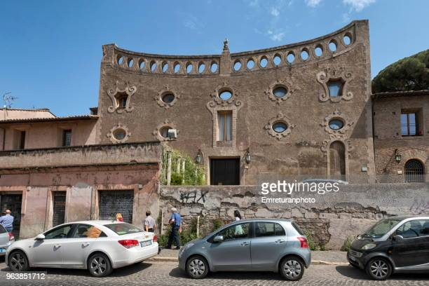 art deco building facade in a rome street. - emreturanphoto stock pictures, royalty-free photos & images