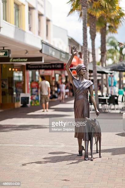 Art deco statue of woman and dog on Emerson street. In Napier, Hawke's Bay.