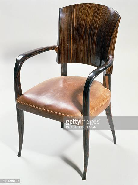 Art deco style armchair by JacquesEmile Ruhlmann Macassar ebony and upholstered in leather France 20th century