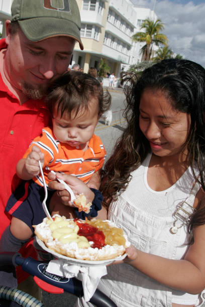 Art Deco Weekend Family enjoying Snack Pictures | Getty Images