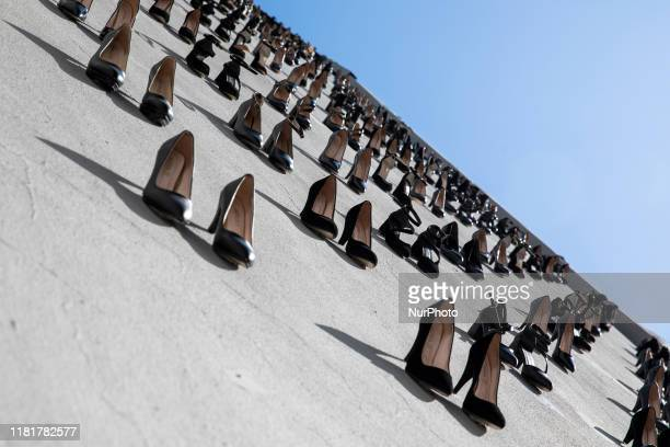 Art design representing the 440 women those who were killed in 2018 in Turkey made with 440 high heels by artist Vahit Tuna is displayed on a wall to...