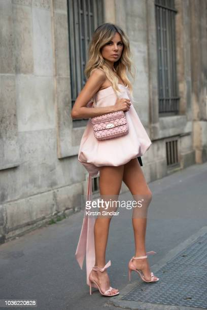 Art director and contributor at Vogue Erica Pelosini wears a Valentino dress and bag with Alexandre Birman shoes during Haute Couture Fall Winter...