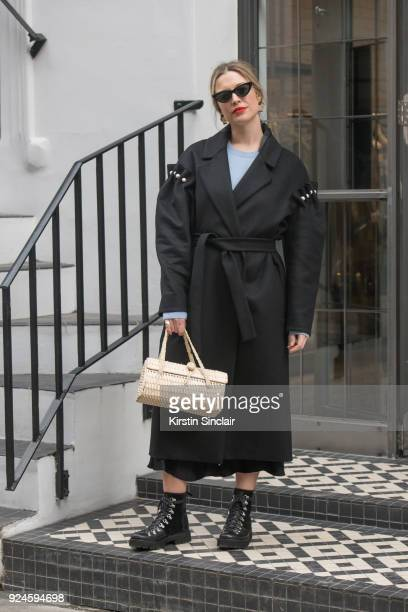 Art Director and founder of Style Memos Alexis Foreman wears a Mother of Pearl coat HM sweater Zara boots sunglasses bag and skirt on day 5 of London...