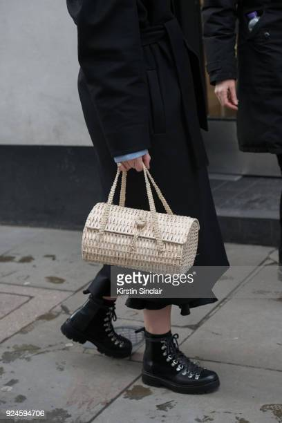 Art Director and founder of Style Memos Alexis Foreman wears a Mother of Pearl coat Zara boots and bag on day 5 of London Womens Fashion Week...
