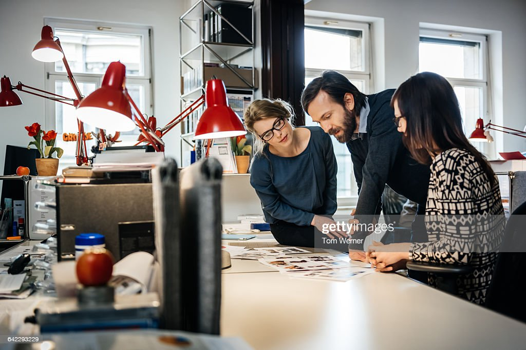 Art director and graphic talking about Layout : Stock Photo