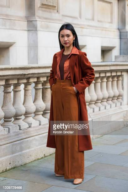 Art director and stylist Pear Chimma wears a Vintage coat shirt and trousers Blue Merry Scott shoes Other stories earrings during London Fashion Week...