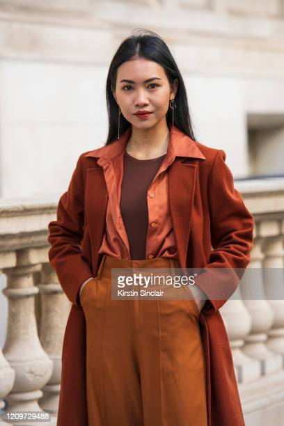 Art director and stylist Pear Chimma wears a Vintage coat shirt and trousers Other stories earrings during London Fashion Week February 2020 on...