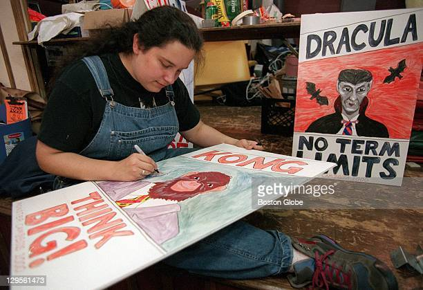 """Art Director, Julia Tenney, works on posters for the """"Monster Election"""" theme of this year's haunted house, which will benefit the Boys and Girls..."""
