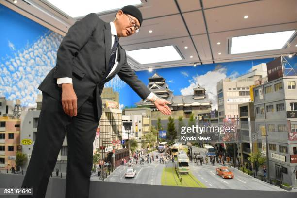 Art director Toshio Miike explains on Dec 15 a diorama replicating the predisaster landscape of the castle city Kumamoto set up in Contemporary Art...