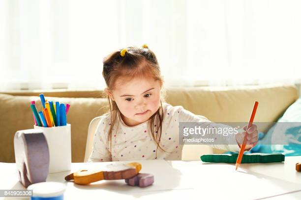 art education for disabled children - down syndrome stock pictures, royalty-free photos & images