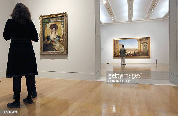 Art enthusiasts admire two painting's entitled 'Rome from the Vatican' and 'Jessica' by English artist JMW Turner during the 'Turner and the Masters'...