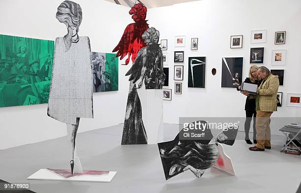Art enthusiasts view the contemporary art on show at the Frieze Art Fair in Regents Park on October 14 2009 in London England The annual air fair...