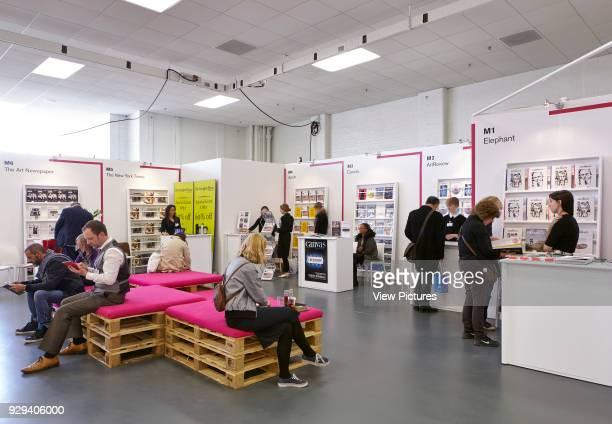 Art fair bookshop with people Art15 London London United Kingdom Architect Stiff Trevillion Architects 2015