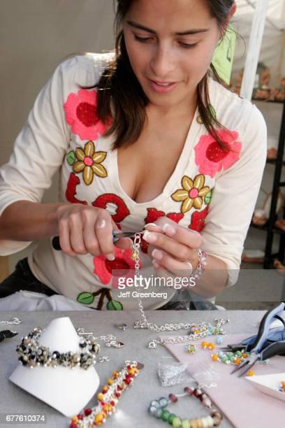 Art Festival Hispanic woman making jewelry