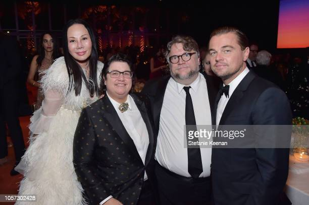 LACMA Art Film Gala cochair Eva Chow honoree Catherine Opie honoree Guillermo del Toro and LACMA Art Film Gala cochair Leonardo DiCaprio all wearing...