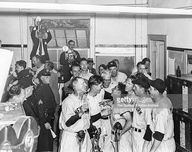 Art Fletcher, Marvin Breuer, Earle Combs, Johnny Murphy, Phil Rizzuto, Red Rolfe, Tommy Henrich and Johnny Sturm of the New York Yankees celebrate in...