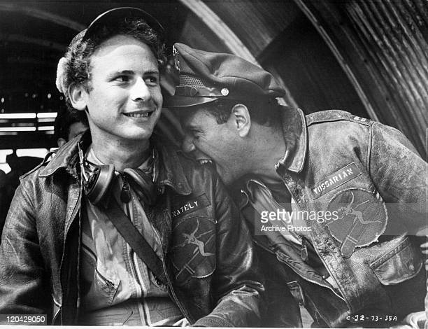 Art Garfunkel and Alan Arkin share a happy moment in a scene from the film 'Catch-22', 1970.