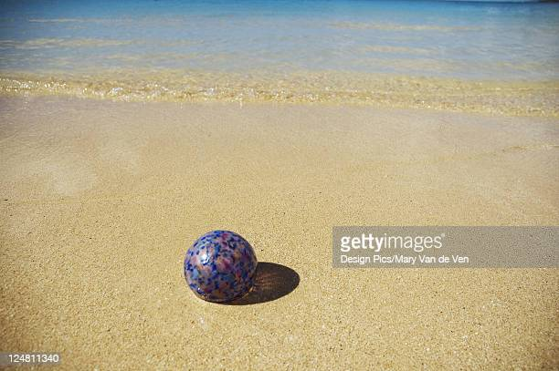 art glass float on sandy beach with calm ocean. - blue balls pics stock pictures, royalty-free photos & images