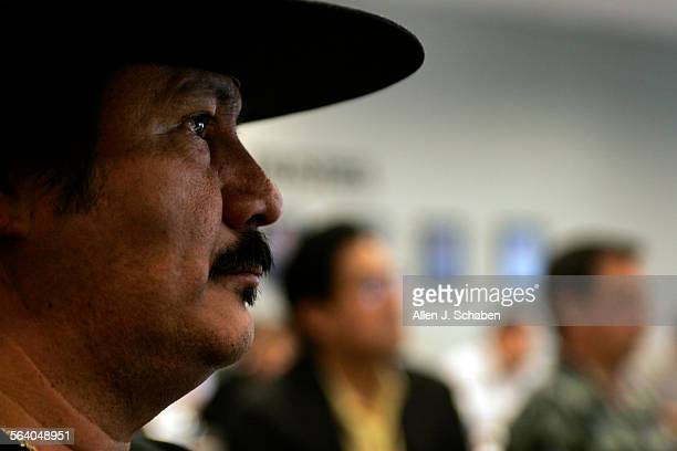 Art Guevara left of Los Amigos of Orange County listens to Orange County Sheriff Mike Carona Costa Mesa Police Chief John Hensley and Nativo Lopez...