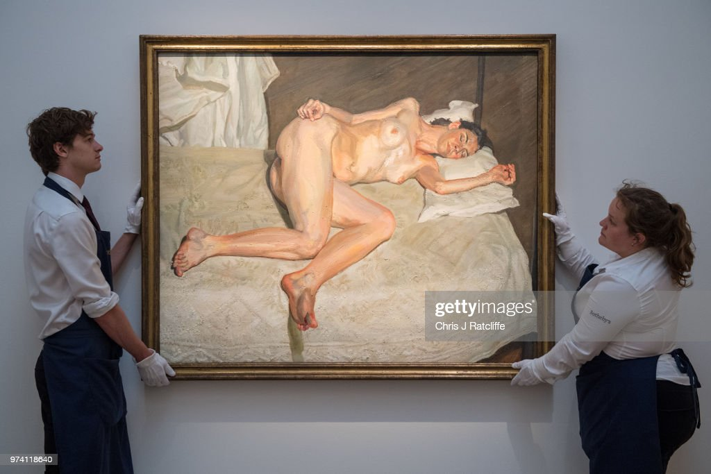 Art handlers adjust 'Portrait on a white cover' by Lucian Freud (estimated at £17 million to £20 million) during a preview of the Contemporary Art sale at Sotheby's on June 14, 2018 in London, England. The sale will take place on 26 June 2018 and includes works by artists Hockney, Freud and Basquiat.