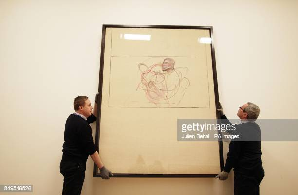 Art Handlers Ger Crotty and Christopher Forde lifting works of art in the Hugh Lane Gallery in Dublin by Francis Bacon including 'untitled' self...
