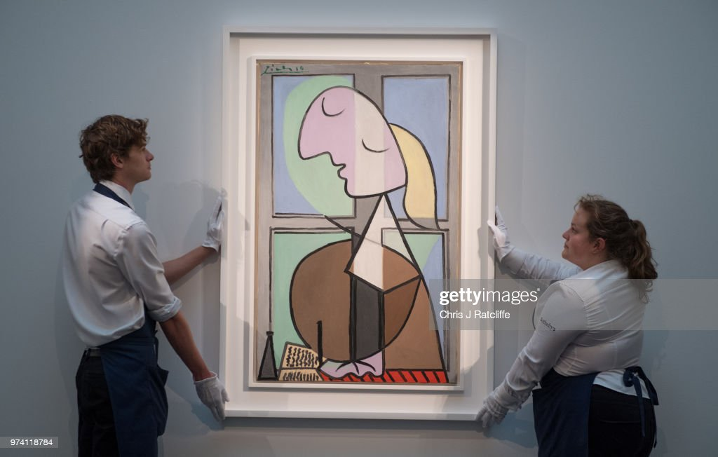 Art handlers hang 'Buste de femme de profil' by Pablo Picasso (estimated at £33 million) during a preview of the Impressionist and Modern sale at Sotheby's on June 14, 2018 in London, England. The sale will take place on 19 June 2018 and includes works by artists Picasso, Monet, Kandinsky and Matisse.