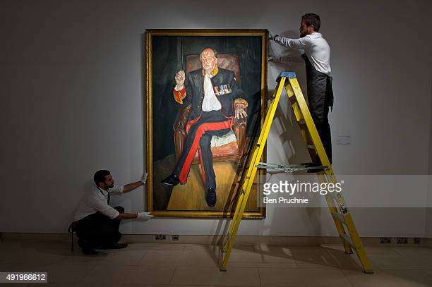Art handlers hang the painting 'The Brigadier' by artist Lucian Freud during the preview ahead of Christie's New York post war and contemporary art...