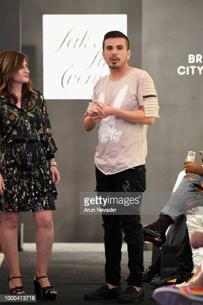 Art Hearts Fashion Executive Director Erik Rosete appears on the runway at Saks Fifth Avenue presentation at Miami Swim Week Powered by Art Hearts...
