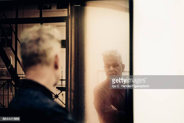 Art historian Per Barclay is photographed for Madame Figaro on January 21 2017 in front of a photography of 'Mercer Street New York 1990' at OSL...