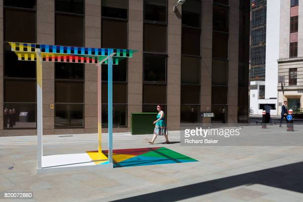 Art in the City artwork entitled 4 Colours at 3 Meter High by Daniel Buren leaves multicoloured patterns from strong sunlight on the pavement at One...