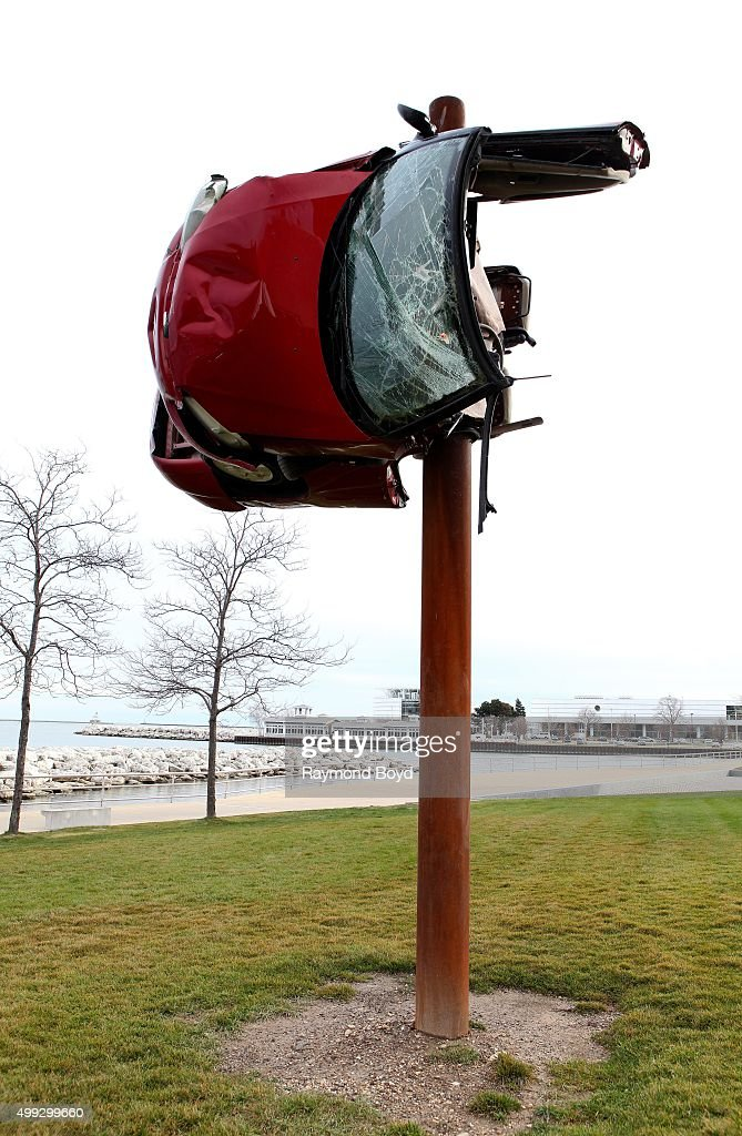 Art Installation Of A Car Wrapped Around A Pole By Artist Dirk