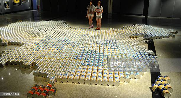 Art installation presented by Ai Weiwei showing a Chinese map made of 2000 baby formula cans representing anxiety over its quality and safety on May...