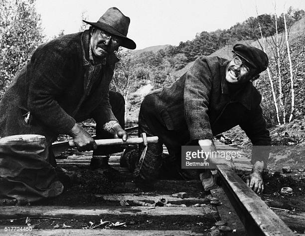 Art Lund and Sean Connery two very active mollies plant dynamite to blow up a coal train in a scene from The Molly Maguires