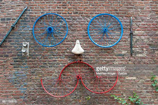 Art Made From Bicycle Parts On Brick Wall