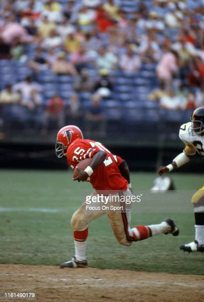 Art Malone of the Atlanta Falcons of the Atlanta Falcons carries the ball against the Pittsburgh Steelers during an NFL football game circa 1972 at...