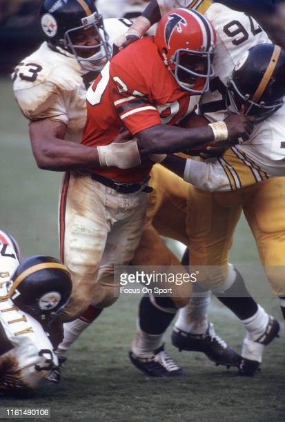 Art Malone of the Atlanta Falcons of the Atlanta Falcons gets tackled by Henry Davis of the Pittsburgh Steelers during an NFL football game circa...