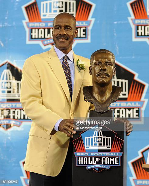 Art Monk of the Washington Redskins poses with his bust during the Class of 2008 Pro Football Hall of Fame Enshrinement Ceremony at Fawcett Stadium...