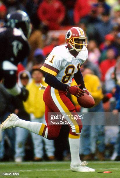 Art Monk of the Washington Redskins runs with the ball after catching a pass against the Atlanta Falcons during an NFL football game November 10 1991...