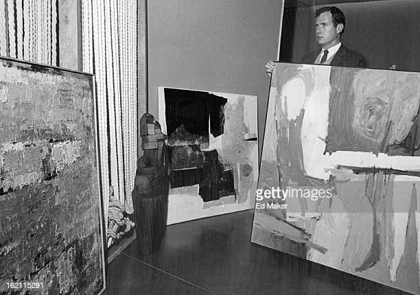 NOV 26 1963 DEC 1 1963 Art Museum Considers Purchases Lewis M Story Denver Art Museum assistant director holds one of four works which jurors in the...