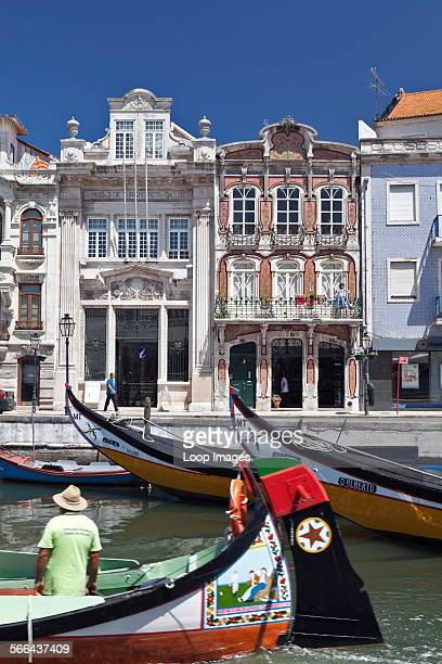 Art Nouveau buildings and the prows of traditional moliceiros boats moored on the canal at Aveiro