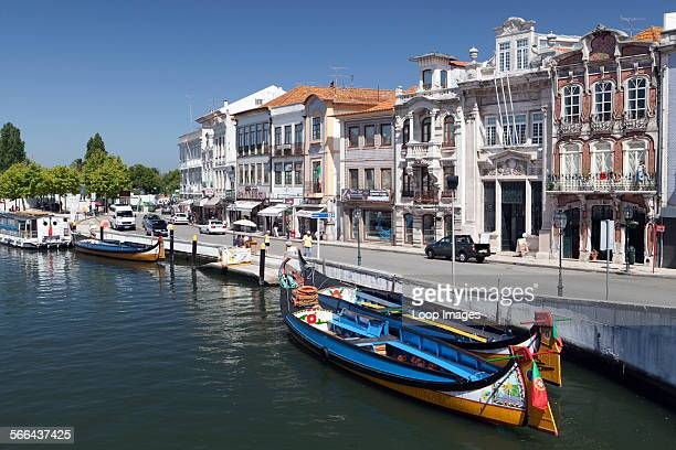 Art Nouveau buildings and traditional moliceiros boats on the canal at Aveiro