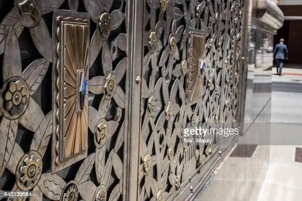 Art nouveau decorative panel on exterior windows of office building